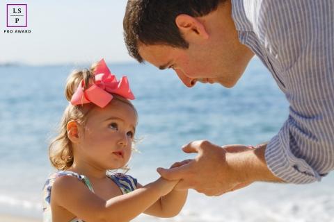 Rio de Janeiro Beach Lifestyle Portrait Photography | Image contains: father, girl, close-up, ocean, sky, hands, color, close-up
