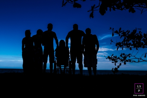 Macae Family Lifestyle Portrait Session | Photo contains: Rio de Janeiro, sunset, blue, silhouettes, trees, outdoors, wheelchair, creative, shot