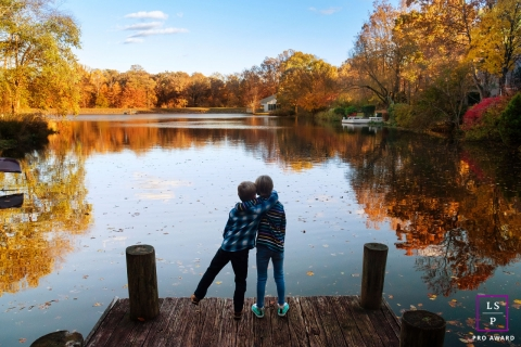 Virginia Family Love Lifestyle Portraits - Photo contains: boys, hug, dock, lake, colorful, fall, leaves, ideas