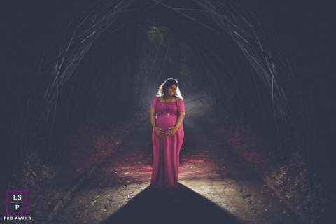 Sao Paulo Pregnancy Lifestyle Portraits - Photo contains: maternity, light, night, outside, branch, tunnel, mother, color, creative