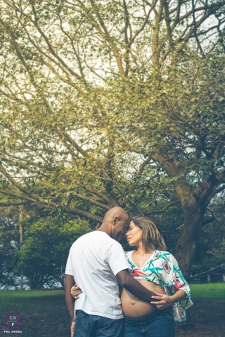 Sao Paulo BR Maternity Lifestyle Photography | Image contains: father, mother, bump, trees, vertical, fine art, color, shot