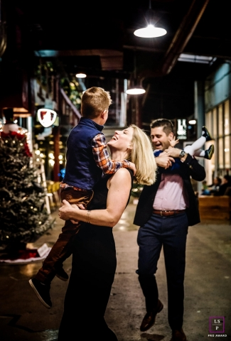 Tennessee Family Lifestyle Portraits - Photo contains: inside, store, family, smiling, color, mother, boy, father, girl