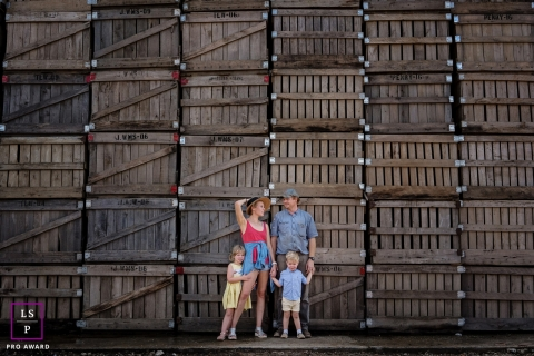 Florida Family Lifestyle Portrait Session | Photo contains: crates, family, outside, color, brown, portrait, kids