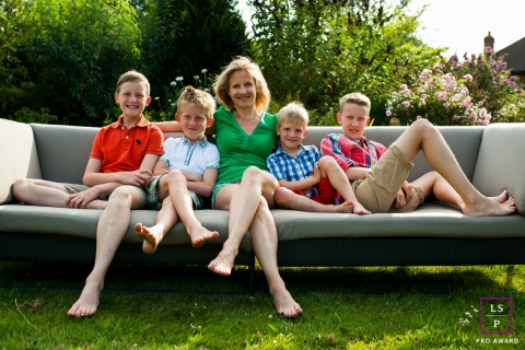 Hertfordshire England Lifestyle Family Portraits - Photo contains: mum, boys, sons, sofa, outdoors, lounging