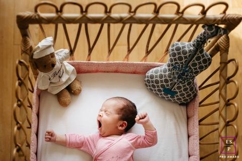 Herault Newborn Baby Lifestyle Portraits - Photo contains: infant, crib, toys, yawn