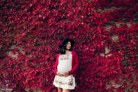 Occitanie Lifestyle Maternity Portraits - Photo contains: pregnancy, wall, red, leaves, woman