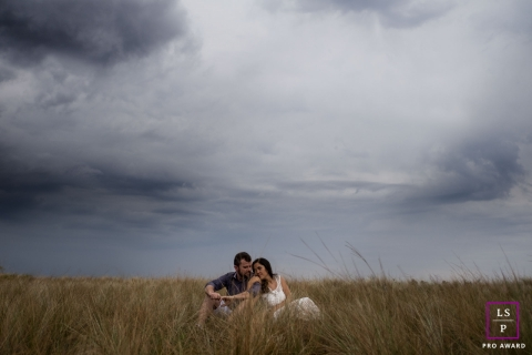 Brazil Lifestyle Couple Photography | Image contains: field, clouds, grass, man, woman