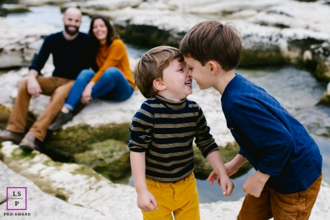 Doubs Lifestyle Portrait Photography of Kids in Bourgogne-Franche-Comte | Image contains: boys, family, rocks, color, outdoors, noses