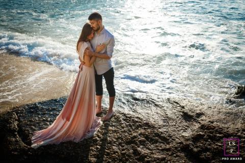 Rio de Janeiro Lifestyle Couple Session | Photo contains: Brazil, beach, rock, color, hug, pre-wedding, wave, couple