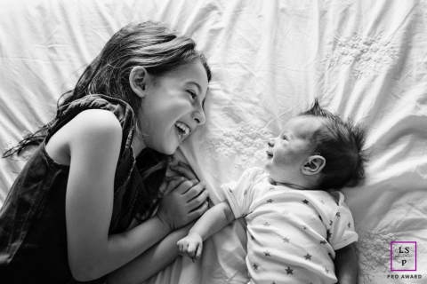 Marseille Lifestyle Newborn Portraits | Bouches-du-Rhone Young girl and newborn brother smiling at each other
