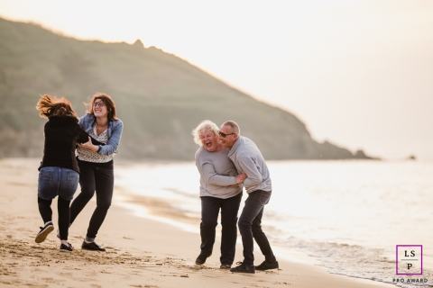Mayenne Lifestyle Family Photography at the Beach | Image contains: Pays de la Loire, water, sand, couple, kids, laughing, playing