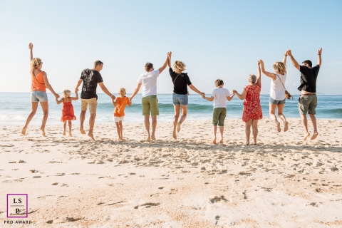 big family jumping in the sand at the beach - Brazil family portrait photography