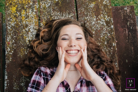 A WA teen tries to hold her smile during lifestyle photo shoot | Seattle Teen Portrait Photography