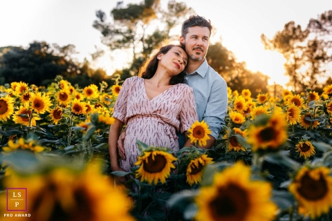 Maternity Photography for Herault - Lifestyle Portrait: future parents in sunflower fields