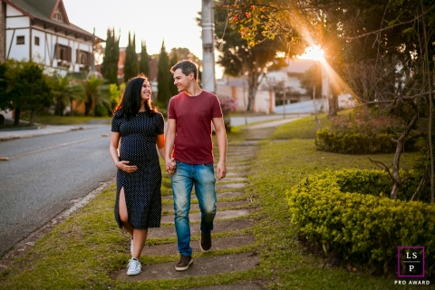 Maternity Photographer in Curitiba, Parana | Lifestyle Image contains: sunset, walk, streets, sunlight, walking