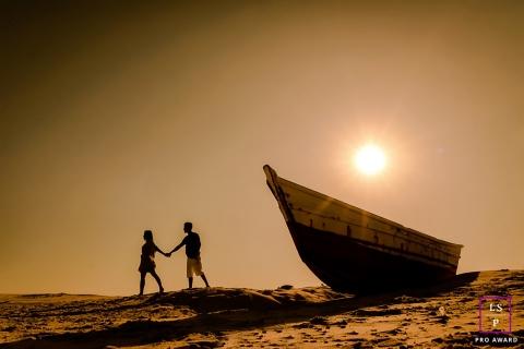 Couple Photography for Minas Gerais Brazil - Lifestyle Portrait contains: beach, walk, sand, boat, sunset