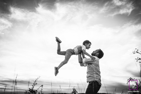 Dad and Son Portraits in Bourgogne-Franche-Comte | France Lifestyle Photography Session: Flying boy with dad