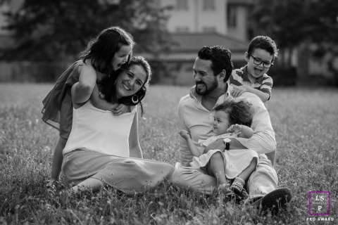 Outdoor Family Photography for Lyon - Lifestyle Portrait contains: dad, mom, children, portrait, yard, home, grass, black and white