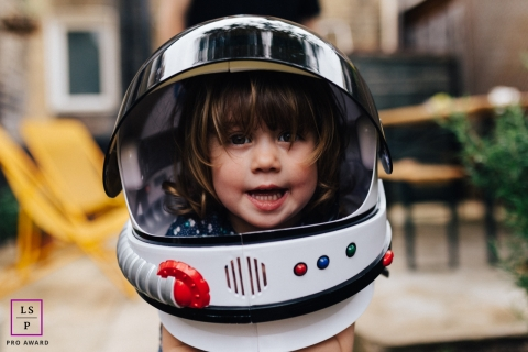Child Photographer in London England | Lifestyle Image contains: kid, portrait, backyard, space, helmet, patio