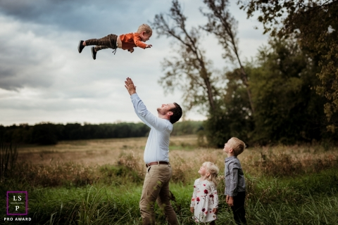 Indiana family portraits - United States lifestyle photographer session - Dad throwing child in the air so high that it almost gives grandma a heart attack!