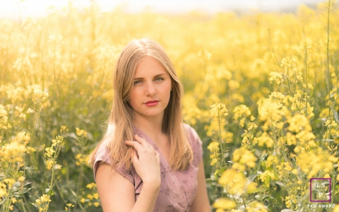 Vendee, Pays de la Loire Teen portrait in yellow fields of France countyrside