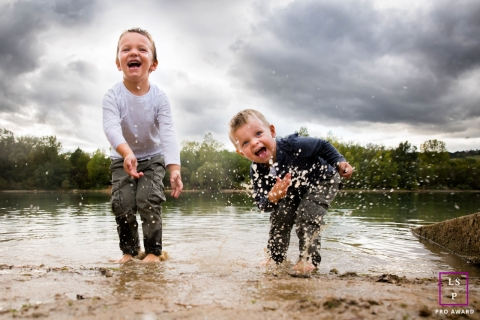 Water battle between brothers as they play during a family photoshoot in Auvergne-Rhone-Alpes