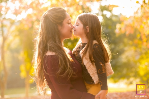 Mom and daughter touch noses in this naturally sunlit portrait in Parana, Brazil