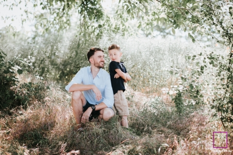 Father and son pose amongst trees and grasses for this French Lifestyle Portrait
