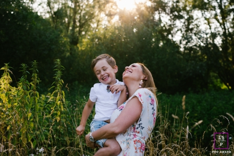 Mom and son laughing together during this French Lifestyle Portrait Session