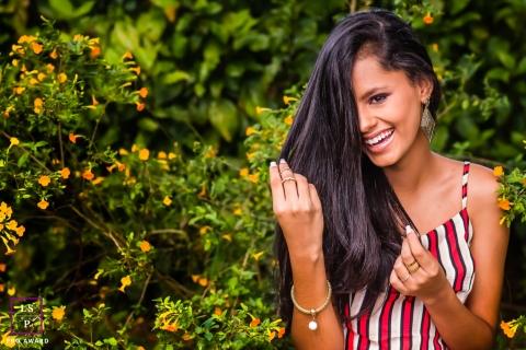 Sorriso, Caratinga, Brasil lifestyle teen portrait within trees with orange flowers