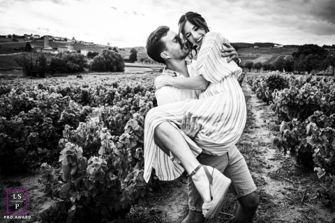 French Lifestyle Portrait of two adults playing like children in the vineyards
