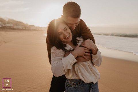 France lifestyle couple photography session in New Aquitaine with them Laughing on the beach