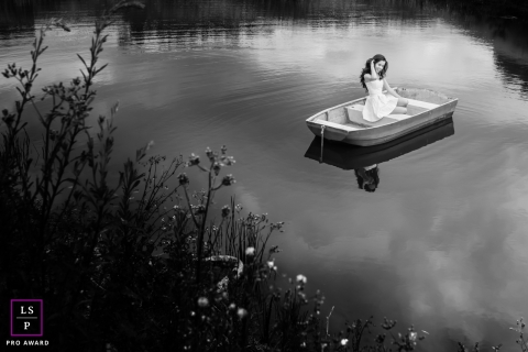 Minas Gerais Brazil lifestyle teen portraits with a girl out in a solo row boat on the water in black and white