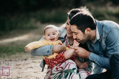 A family lifestyle session in the mountains of Pyrénées-Orientales, France with a young couple and their baby