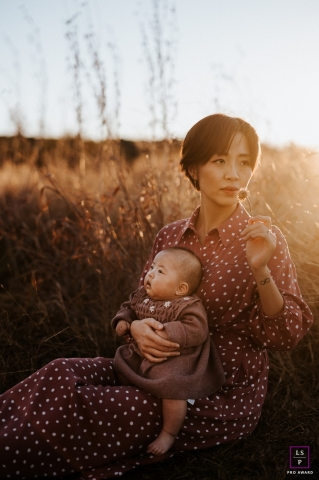 Nashville motherhood moment with her baby in this lifestyle portrait in a field