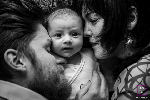 Savoie close-up on the faces of a baby and his 2 parents during this Auvergne-Rhone-Alpes family portrait session