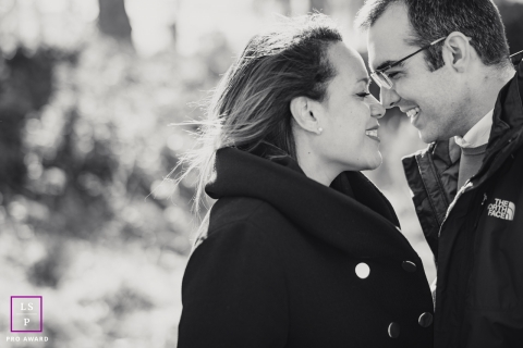 Madrid husband and wife smiling at each other during this portrait session
