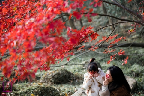 Hangzhou City mother and daughter under the maple leaf for a family portrait session in Zhejiang