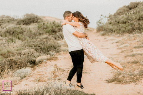 Vendee Creative Lifestyle portrait of a couple dancing in dunes