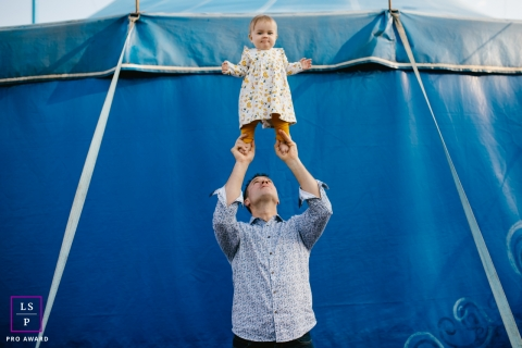 Artistic Doubs Lifestyle Photography showing some acrobatics at the circus with dad