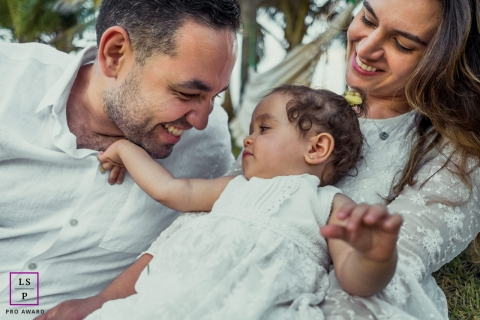 Alagoas Creative Family Lifestyle Portrait image capturing the love of father and baby with mom