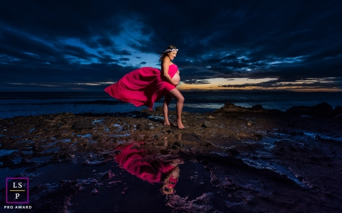 Maternity lifestyle portrait shot during blue hour on a Costa Rica beach.