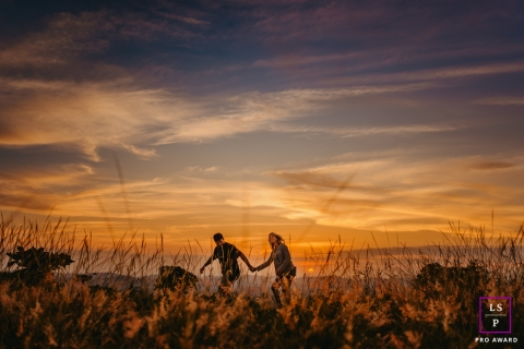 Brazilian couple posing for a creative Lifestyle image as they walk at sunset