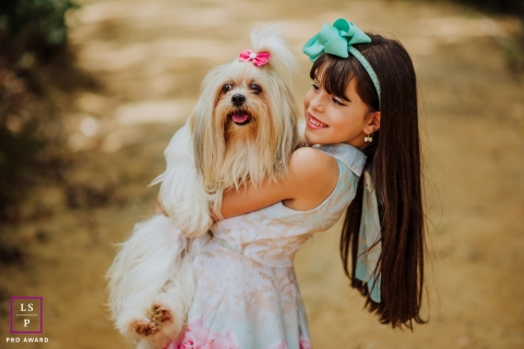 Minas Gerais on-location, outdoor Lifestyle Pet Portrait of a dog held by a young girl