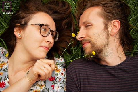 Zwolle couple poses for lifestyle portrait having a sweet time together laying in the grass