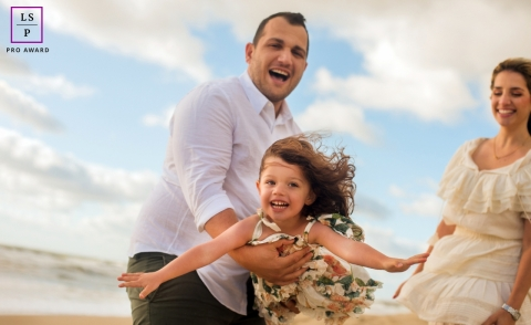 New Jersey Family poses for a lifestyle photograph with some fun at the beach