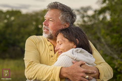 New Jersey couple poses for a lifestyle portrait as they embrace