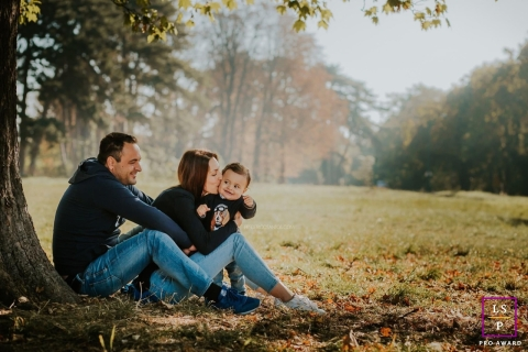 Paris Family poses for a lifestyle portrait in the woods