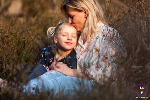 Gelderland Family image of mother and child posing for a Lifestyle portrait in nice afternoon light