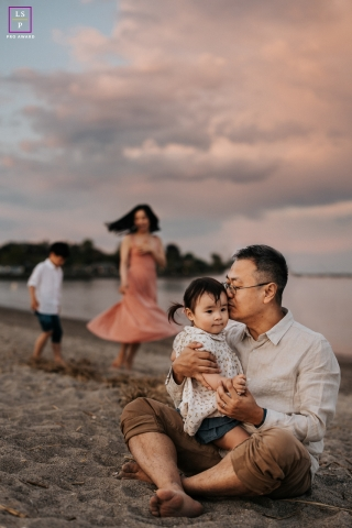 Oregon Family posing for a Lifestyle portrait and a beach session